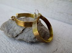Artisan hand forged stamped brass large hoops free by Amayeli, $18.00