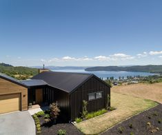 On an idyllic outcrop with stunning views of Lake Taupo, this couple built a bespoke new home perfect for their way of life Guest Bedrooms, Master Bedrooms, Waterfall Taps, Bedroom Arrangement, Cosy Corner, Built In Bookcase, Building A New Home, New Builds, House Tours