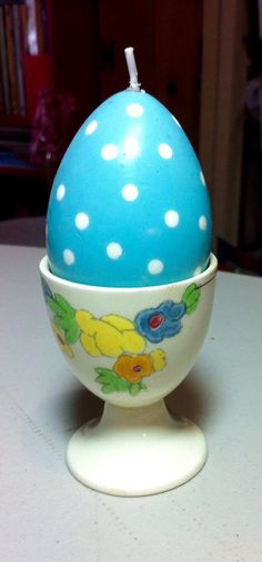 Featured is an antique ,Royal Doulton , made in England, ceramic egg cup . I have included an Easter egg candle. Add this to your collection of