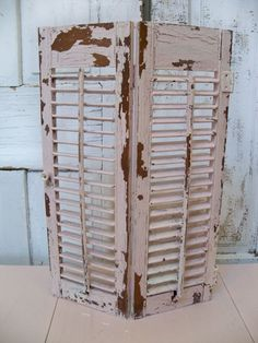 Distressed hand painted shutter wooden shutter shabby chic table or wall decor Anita Spero. $52.00, via Etsy.