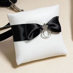 <p>Our Dog Ring Bearer Pillow is the perfect way to make your favorite canine part of your special day! Simply tie the black satin ribbon around your dog's shoulders and onto his leash and your
