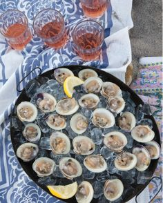 Raw clams, such as these cherrystones and littlenecks, are easiest to open when they've been chilled for a few hours; the cold relaxes the muscle that keeps them clamped shut. Use a thin-bladed clam knife, which, unlike a pointed oyster knife, has a rounded tip and one sharp side. Serve them on a bed of ice with chilled glasses of rose.