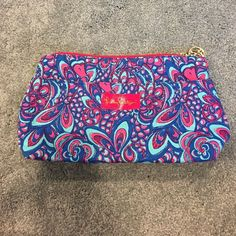 Lilly Pulitzer pouch Pretty big excellent condition. Originally came with clear case but I use that. Two pockets. Lilly Pulitzer Bags Cosmetic Bags & Cases