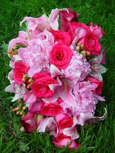 Cascade bouquet of pink peonies, lilies, hot pink roses, calla lilies and pink hypericum berries.