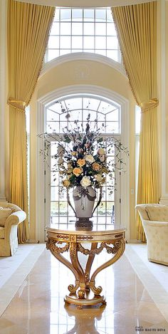 Absolutely stunning floor to ceiling yellow draperies and mounted at the front entry for a extremely dramatic look.
