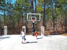 In the middle you can see Tim's kids shooting some hoops at their Pro Dunk Platinum Basketball System.