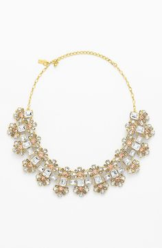 So shiny and sparkly! Will pair this Kate Spade peach and clear crystal collar necklace with a pretty fit & flare dress.