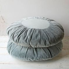 Cosy and luxurious, these round velvet cushions by Madam Stoltz are perfect for layering up on the sofa and are super soft to touch. Click through to shop.