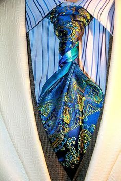 """Save 33% promo code TIEGUY33. STAND BACK!!! BACK DAMN IT...BACK!! Because this BLUE DRAGON (deux) STERLING-SCOTT Tie, is Breathing Seductive Blue Flames of """"SHHAAAZAM""""!! to all that are taken by this Electric Blue Embroidered Satin with Strikes of Emerald Green and Flashes of Sun Brust Yellow, paired with a Strom on the Horizon of Ocean Azul, Redwood Amber, Midnight Blue, Warm Caribbean, capped with an FLAME of Electric Blue!! Makes this 1 of 4 STERLING-SCOTT Ties come with a STORM WARNING…"""
