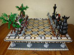 Since Lego has released several chess sets I thought why not build a LOTR chess game.