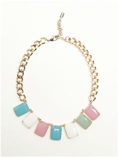 Machine cut crystals with white metal and brass castings attached to a curb-style chain.
