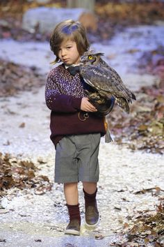 Kids fashion from Italy with the amazing forest catwalk at Il Gufo featuring a boy and his pet owl at Pitti Bimbo 80 for fall 2015 kids fashion