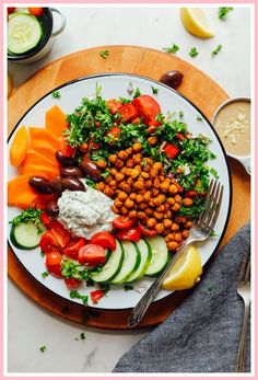 Greek-inspired bowl with vegetables, tabbouleh, vegan tzatziki, and crispy baked chickpeas! A healthy, satisfying entrée or snack. Baker Recipes, Cooking Recipes, Amish Recipes, Easy Recipes, Vegetarian Cooking, Vegetarian Recipes, Shawarma Spices, Vegan Tzatziki, Vegan Greek