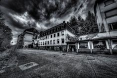 The Clinique Du Diable is a big complex with six buildings. This is the view from the front to the main building with some of the employees' houses. Urban Exploration, Abandoned, Entrance, Maine, Clouds, Explore, Mansions, Black And White, House Styles