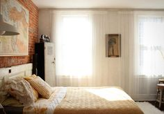 soft and sweet. love the brick wall and sheer curtains. via blood & champagne