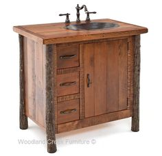 This beautiful hickory log vanity is handcrafted with natural hickory logs and reclaimed barn wood. The combination of logs, barnwood, copper and hand forged hardware is one beautiful rustic vanity. Notice the hickory logs still have their bark. When harvested at the correct time of year, hickory will maintain its bark forever. The bark adds