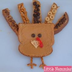 It's TURKEY time!! ~~~~ Tom Turkey ~ Bread ~ Peanut Butter ~ Embellishments ~ Pretzel Sticks ~ Spread peanut butter or anything sticky on 2 pieces of bread.  Cut one piece into 5 pieces (as sh...