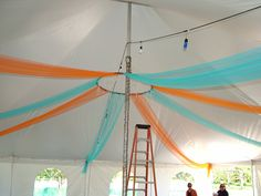 tent decoration: start with a hula-hoop suspending from the pole and then ting fabric from the hoop and go out from there