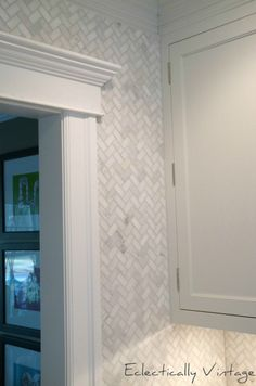 Back splash herringbone tile or wallpaper? Waterproof wallpaper I could do, just so it's easy to wipe off.  Much easier than tile for me.