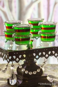 This purple and green layered jello shot recipe is awesome! Made with vodka and … This purple and green layered jello shot recipe is awesome! Made with vodka and …,yemek This purple and. Halloween Jello Shots, Halloween Party Drinks, Halloween Bottles, Halloween Ideas, Halloween Halloween, Blue Jello Shots, Making Jello Shots, Jelly Shots, Maleficent Party