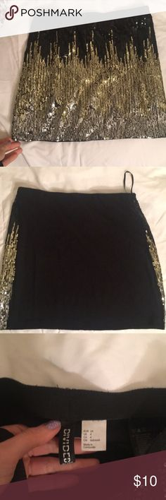 H&M skirt H and M skirt seuined in front silver, gold, black sequins. All sequins in tact very good condition only worn for an hour. H&M Skirts Mini