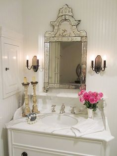 Small space genius -- love the marble mantle-style vanity -- provides an extra ledge for goodies