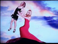 Amy Schumer holding up Jennifer Lawrence like Simba in The Lion King.  This was a prize awarded to late night tv host James Corden after winning the game Artistic Masterpiece Or Something That Justin Timberlake's Music Reminds Me Of on the TV show Billy On The Street