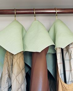 Twenty-inch cloth napkins (or same-size squares of fabric) become protective covers for coats and vests that don't need to be stored in garment bags. Each is pierced in the center and reinforced with a grommet to slide over a hanger.