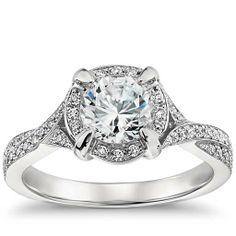 I love the band on this! I would like it more without the halo around the round diamond. Monique Lhuillier Twist Shank Engagement Ring in Platinum