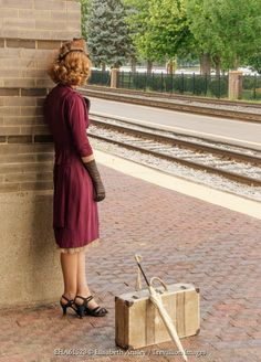 Elisabeth Ansley RETRO WOMAN WITH SUITCASE AT TRAIN STATION Women