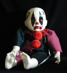 One Of A Kind Design - Original Design Outfit This little cutie is about 15 inches in length. His head, arms and legs are made of vinyl and the body is cloth. Clown suit is a Darkling Designs original . The clothing is not removable. He is painted with quality acrylics and sealed for lasting color and durability. If you look at the picture of his foot, you can see that he has a crackle finish. :) Darkling Dolls are intended for display only, not to be used as a toy.    Darkling Dolls use…