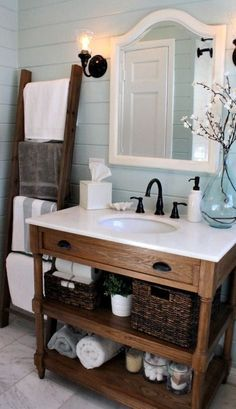 Loving this bathroom: ladder for linens, nice rustic but chic vanity, pretty blue plank walls