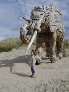"""Driftwood elephant sculptures along the Belgian coastline from the """"Ungayithenga inhlizyo nomongo wami"""" (""""You can buy my heart and my soul"""") public art installation by South African artist Andries Botha"""