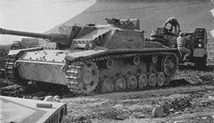 German Sturmgeschütz III (StuG III) captured in the North sector of Cassino by US 5th Army's troops (note an American AFV in background) as described by the Report of the New Weapons Board, Office of the Commanding General, Army Service Forces, Washington, D.C., April 1944 (Italian Fifth Army Area - Ordnance Materiel). This StuG later was used as target for bazooka demonstration.