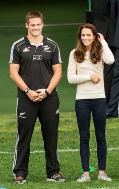 Kate watches her husband as he takes part in Rippa rugby, a non-contact version of the sport at the stadium in Dunedin, New Zealand. April 13, 2014.