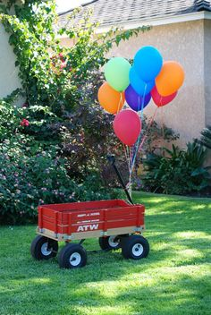 Tie balloons to the wagon for the photo area...