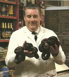 Alphie and his black pudding. In Britain, people eat fried congealed pigs' blood. Coronation Street Blog, British Drama Series, Black Pudding, Places In England, Puddings, Pigs, Soaps, Britain, Irish