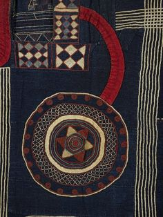 Kusaibi gown made from 14 narrow strips of cotton hand-woven on a narrow loom and dyed indigo; hand sewn together