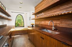 Original Lath as backsplash!!!  and I love the walnut counter top!  contemporary kitchen by Hsu McCullough