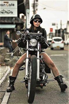 Works on her own bike.