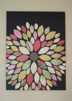 Wall flower tutorial. Could definitely be a wallhanging idea. made with paper, but would be a fun quilt (although it would take much longer to make!)