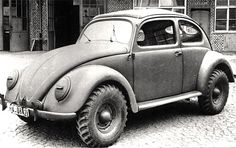 redhousecanada:  1943 WW2 Beetle, type 87 in wartime livery. It has the 4x4 drivetrain of the Schwimmwagen, but with a KDF sedan body.  Also known as a Kommandeurwagen.