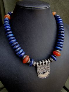 Necklace | Nancy Sathre-Vogel. Antique silver pendant which could have originated from Afghanistan combined with lapiz lazuli and carnelian beads