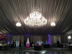 Tent wedding featuring a large crystal chandelier by SignatureChandeliers.com #crystal #chandelier #wedding #tent #tentwedding #weddingchandeliers #weddingchandelier #signaturechandeliers