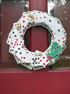 Deck of Cards = Unexpected Holiday Wreath  Poker fans will get a kick out of repurposing a deck of cards as a cheery holiday wreath. Create multiple layers of cards with thick mounting tape; this gives the wreath more dimension. For added whimsy, attach red and green poker chips in one corner to resemble a sprig of holly. Design by Brian Patrick Flynn