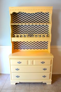 #refinishedhutch We recently bought a house and so I've been knee deep in refurbishing furniture... my mom gave me the dresser (the bottom half), I found the hutch/shelf part at a thrift shop (the D.I.). Anyway, I took off the back of the hutch and covered it with chevron fabric and nailed it back on. Then we screwed the the two pieces together. I spray painted the handles with a silver metallic paint. Voila!