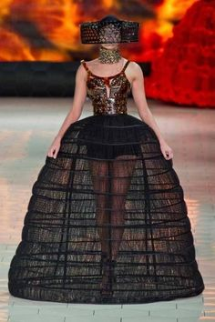 Alexander McQueen for Spring '13, modern interpretation of a stomacher, to me it looks like she forgot to put on her over dress.