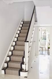 The crisp and elegant navy edged runner lifts this all-white hallway House Stairs, Carpet Stairs, Hallway Carpet, Basement Stairs, Staircase Runner, Stair Runners, Navy Stair Runner, Hall Runner, Victorian Hallway