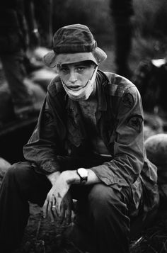 Injured, weary soldier. Name, date, and location unknown.   from Charlie Haughey's collection of Vietnam war