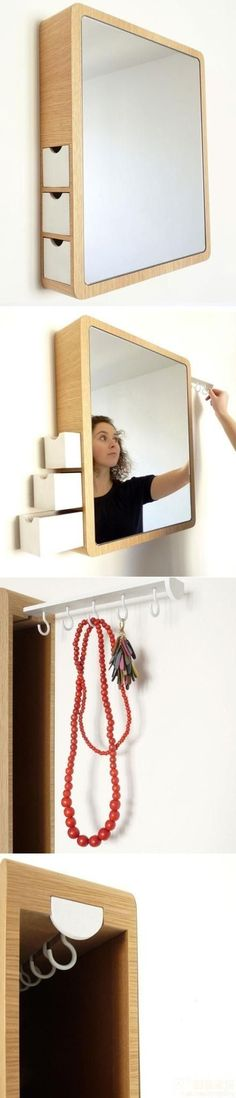 medicine cabinet mirror with hidden drawers and hooks for hanging necklaces etc